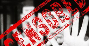 """Black and white picture of a man superimposed with a red stamp that reads """"Censored"""""""